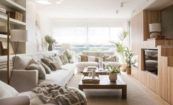 Muebles multifuncionales, luminosidad y calidez en la reforma de un dúplex