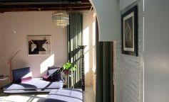 Colores y arcos en la reforma de un moderno loft de Brooklyn